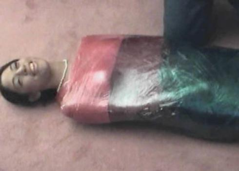 Samantha Love wrapped in plastic